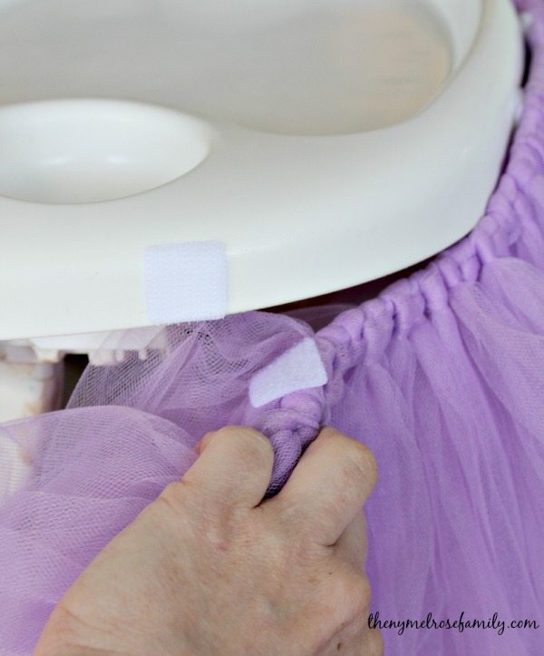up close view of the velcro square on the Highchair and the tutu