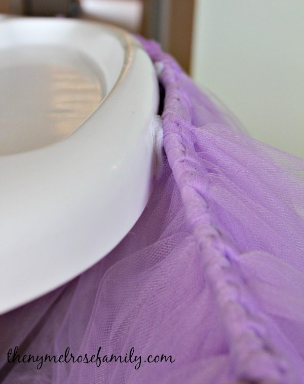 Up close with the attachment of the velcro squares to the No Sew Highchair Tutu for a first birthday party