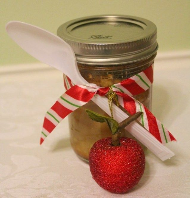 apple pie in a jar with ribbon and spoon