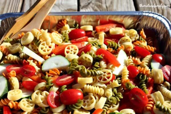 Christmas Pasta Salad with pinwheel pasta and fresh vegetables on a picnic table