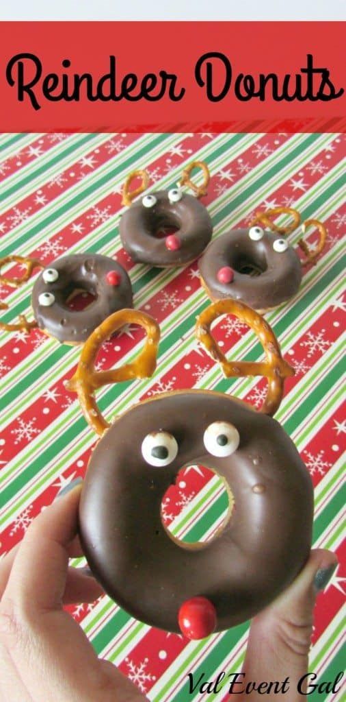 1 Reindeer Donut being held with 3 behind it