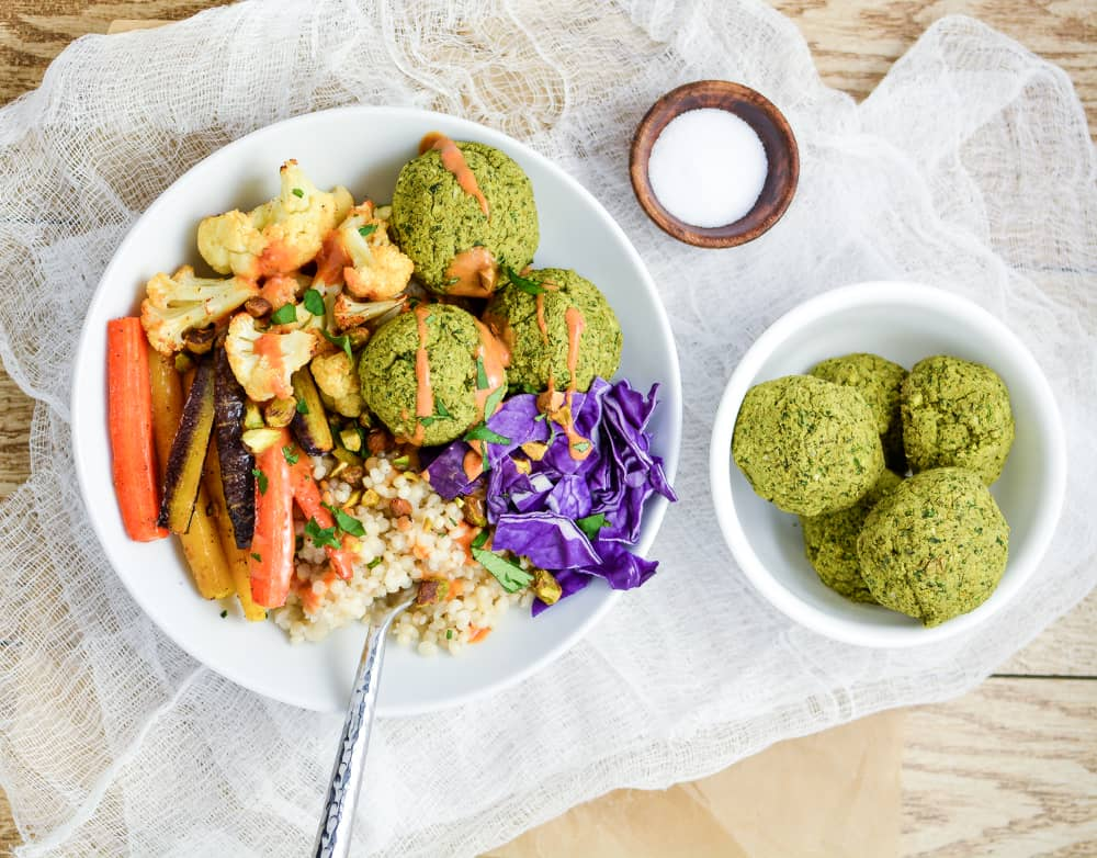 Falafel Couscous Bowl with a side of falafel and salt
