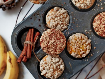 freshly baked banana bread muffins in a tray