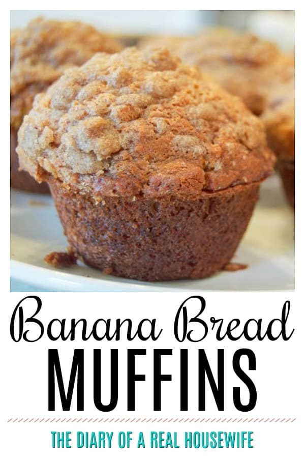 banana bread muffin on a white platter with muffins behind it