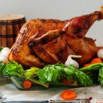 Roasted turkey on a platter garnished