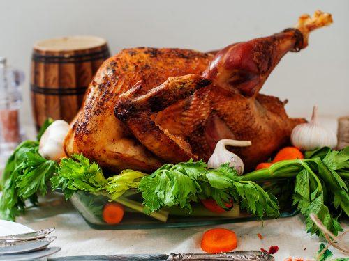 Roasted turkey on a platter garnished
