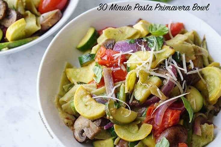Pasta Primavera Bowl topped with cheese