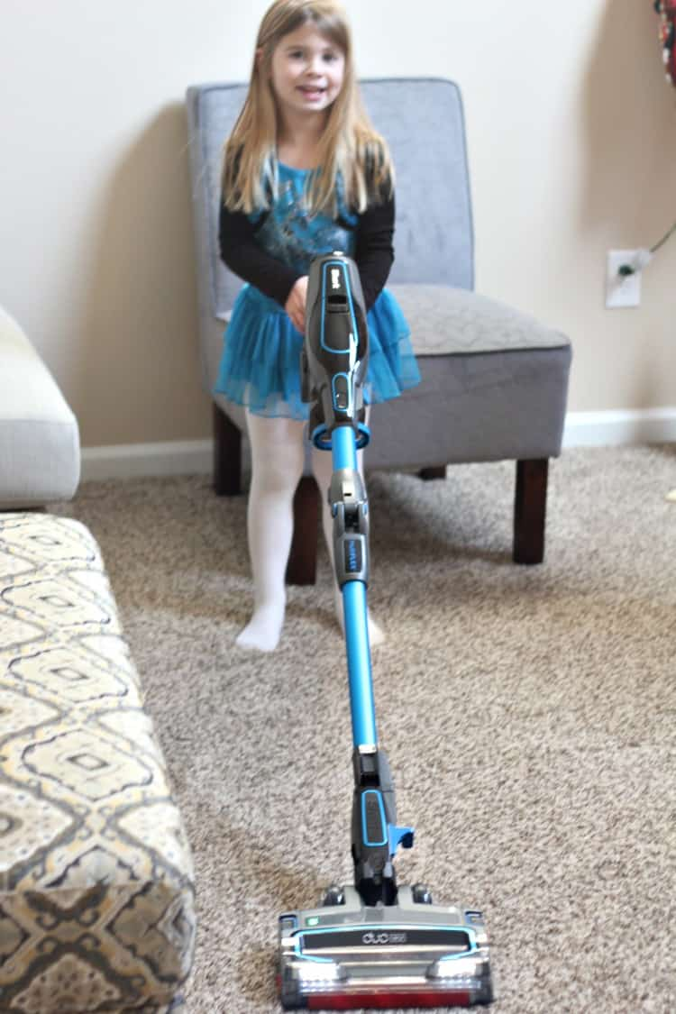 clean house tool of the shark ion flex vacuum and a four year old girl