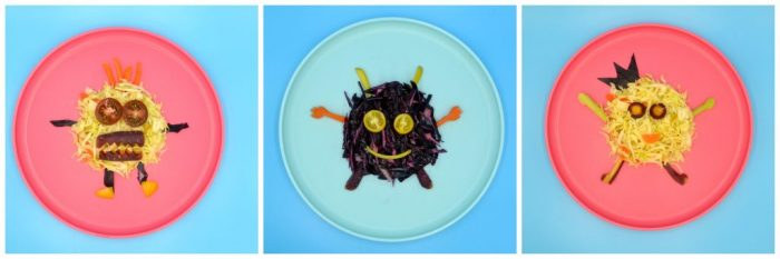 Three different easy coleslaw monsters on two red and one blue plates made from various vegetables.