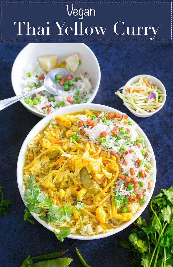 Vegan Thai Yellow Curry in a large white bowl served with fresh vegetables