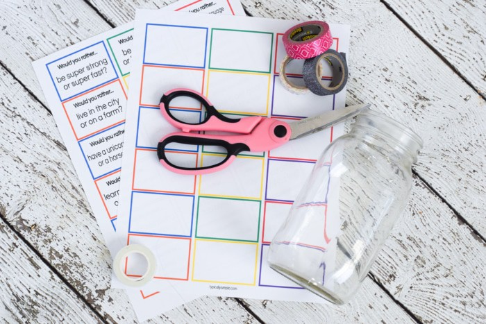 Would you rather for kids supplies of a glass mason jar, scissors, question printable and washi tape.