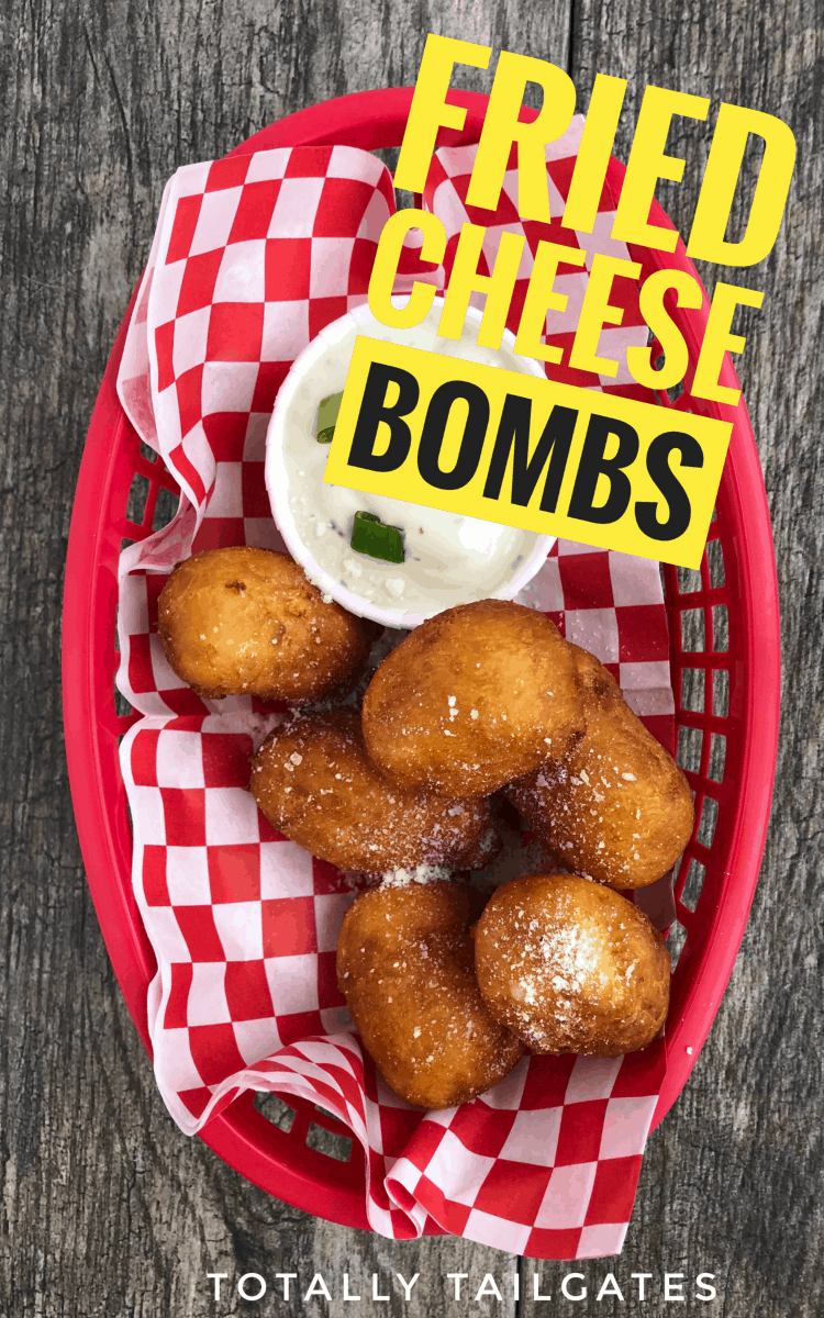 Fried Cheese Bomb recipe in a red basket with ranch dipping sauce in the basket with the other fried cheese bombs