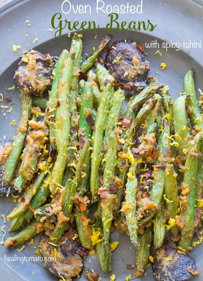 Oven roasted Green beans with spicy tahini and mushrooms up close on a blue plate