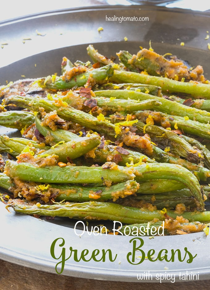 Oven Roasted Green Beans on a silver plate with spicy tahini