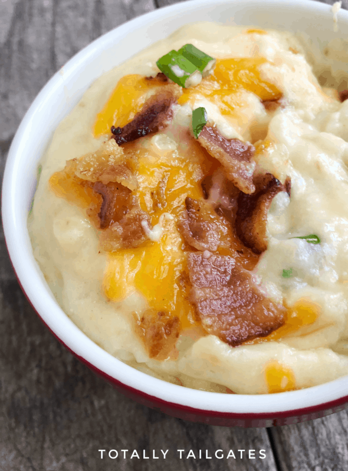 Loaded Baked Potato Soup with cheese and bacon in a white bowl
