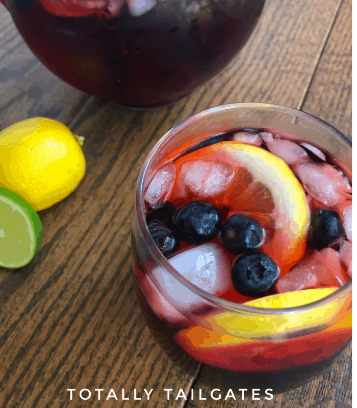 Simple Sangria Recipe with blueberries and lemon slices garnishing the glass