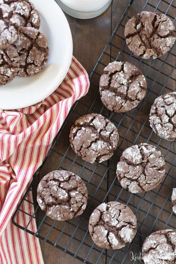 Chocolate Crinkle cookies recipe on a cooling rack pictured from above with a red and white towel next to them
