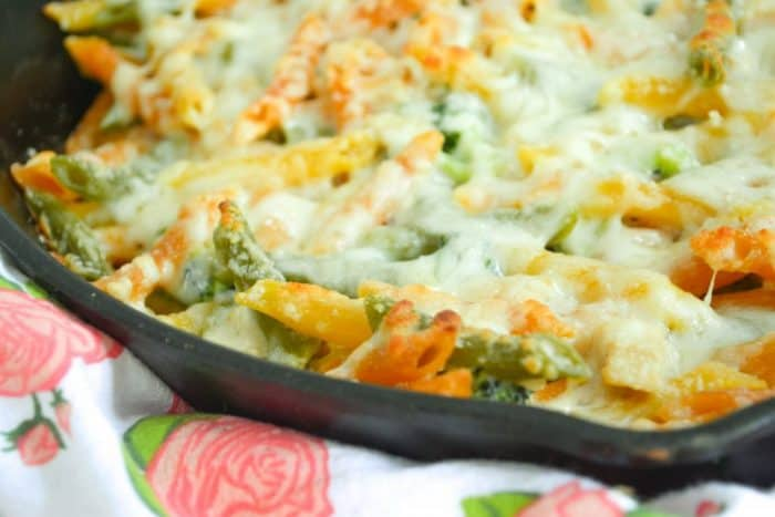 healthy chicken alfredo bake in a cast iron pan up close