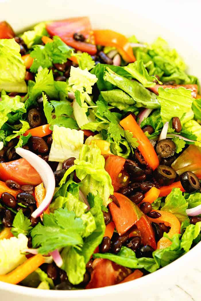 Southwest salad recipe from above with tomatoes, red onion and olives