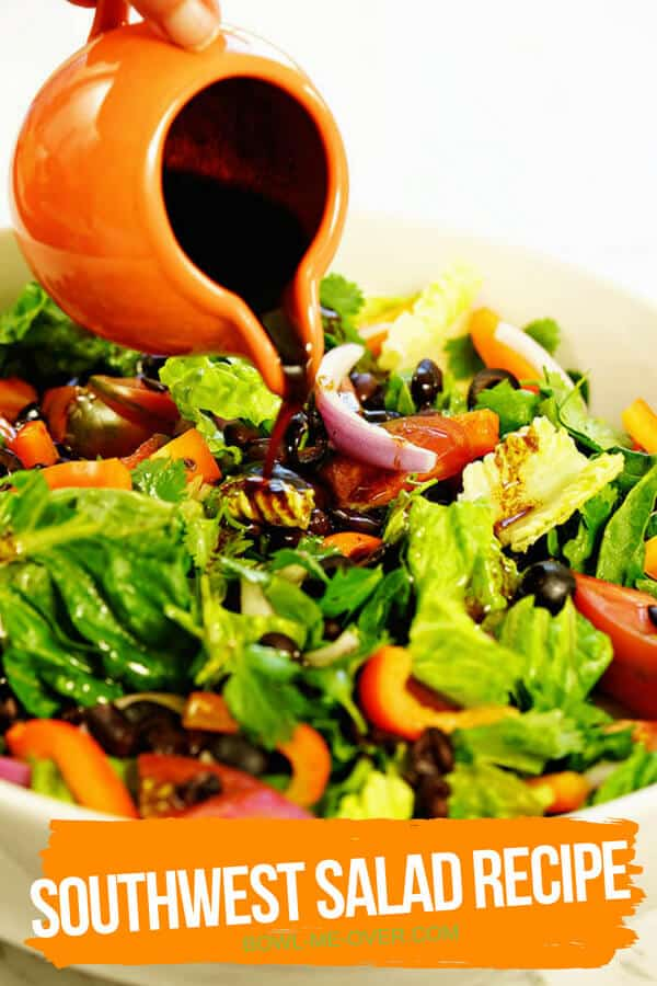 Southwest salad recipe with balsamic vinaigrette being poured over the top from an orange cup