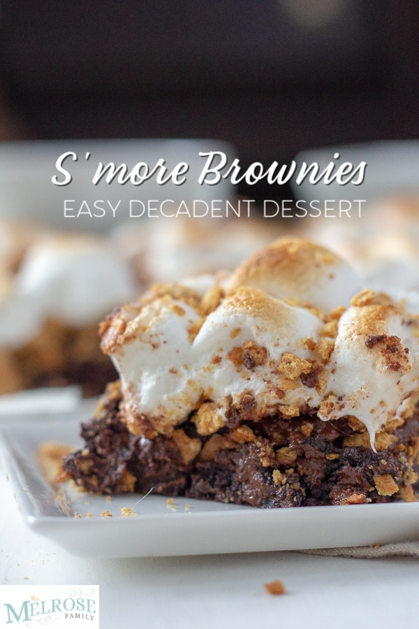 S'mores brownie on a plate with more brownies in the background.