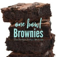 "Brownies stacked up four tall with the words ""One bowl Brownies - The Perfect Fudge Brownie"" in teal across it"