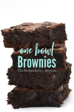 """Brownies stacked up four tall with the words """"One bowl Brownies - The Perfect Fudge Brownie"""" in teal across it"""