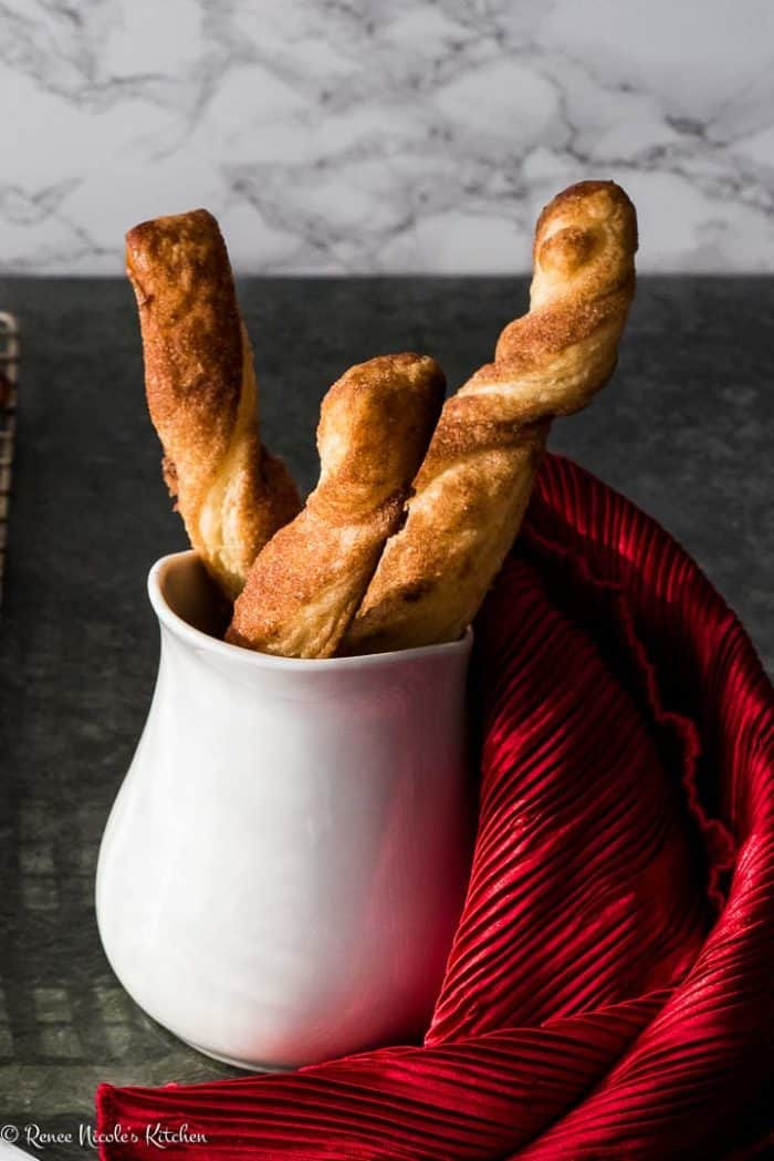 white vase of cinnamon twists with red napkin to the right