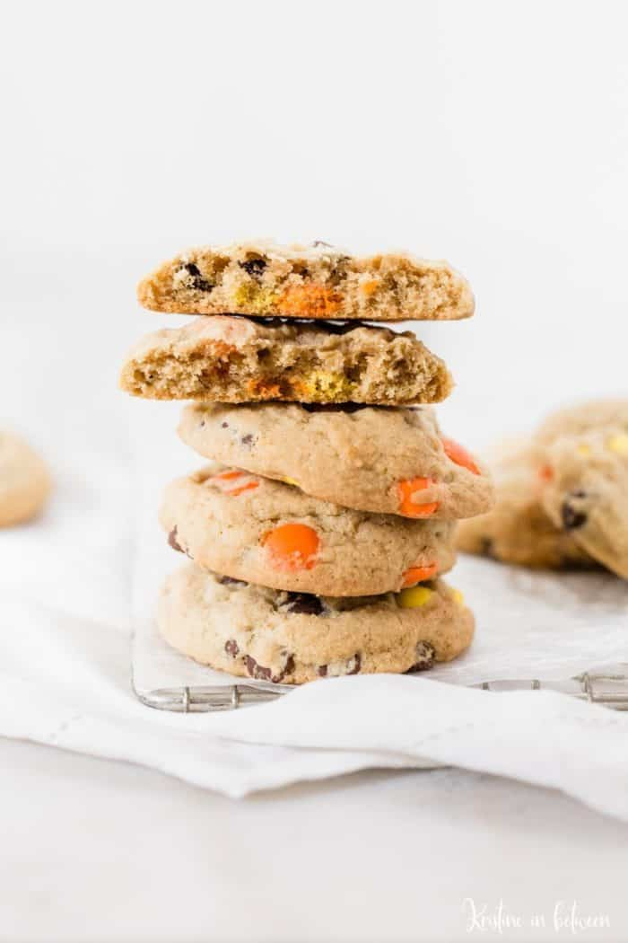 reeses peanut butter cookies stacked 5 cookies high on parchment paper