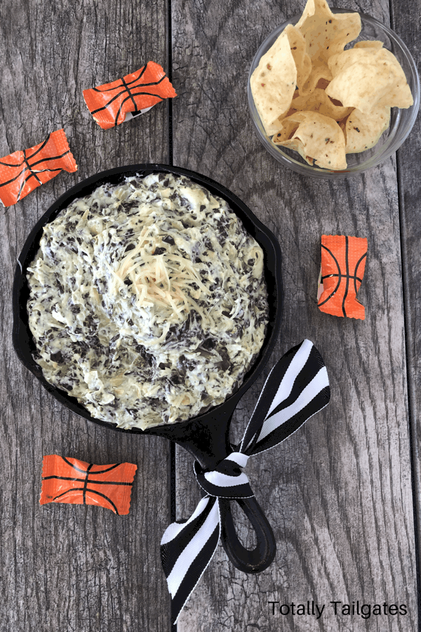 spinach artichoke dip in a cast iron dish