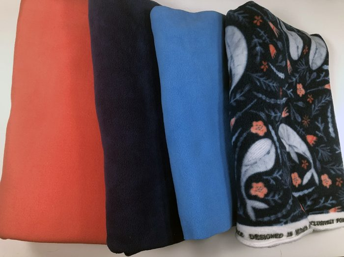 4 different types of anti-pill fleece: red, black, blue, whale pattern