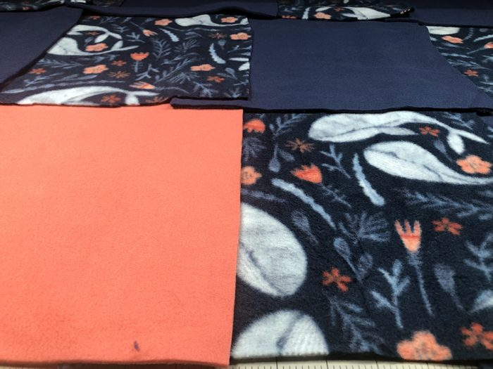 Making a rag quilt arrangement with the fabric