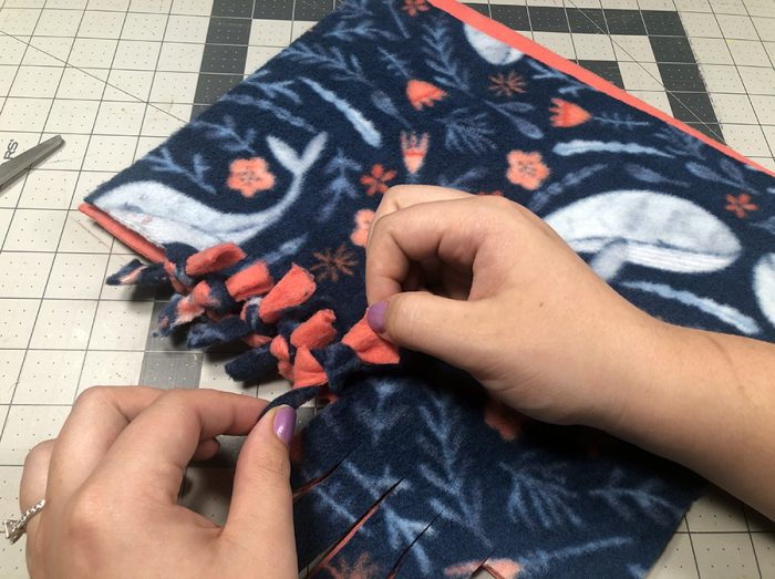 Tying double knots with the fabric