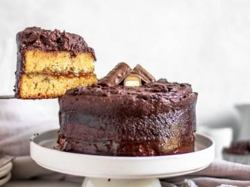 Slicing Twix Cake on a platter
