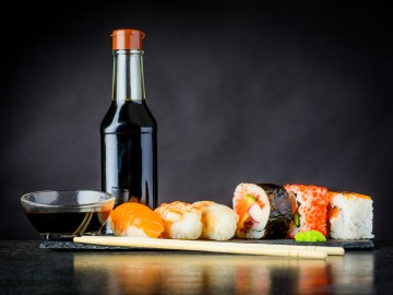 Soy Sauce in a bottle next to sushi