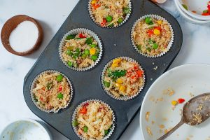 quinoa bites mixture divided in muffin tray
