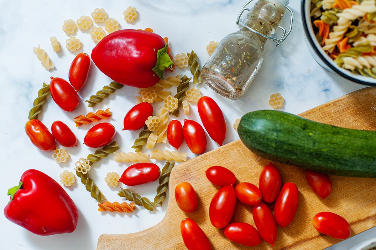 Tomatoes and other ingredients for pasta salad