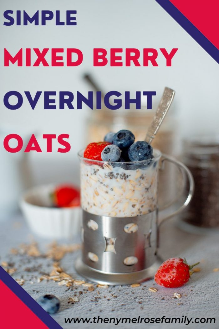 mixed berry overnight oats in a jar with spoon