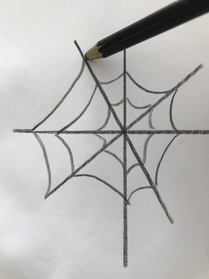 Drawing a spider web in center of a paper