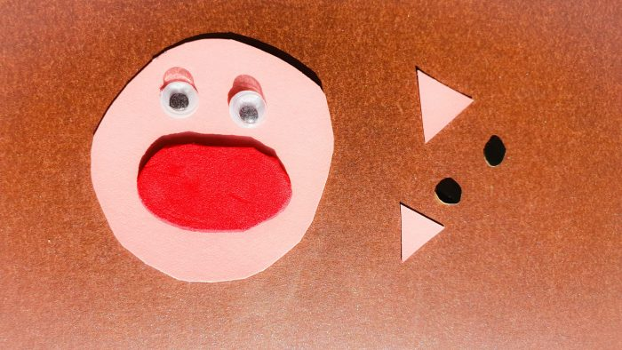 making a pig face using paper pieces and googly eyes