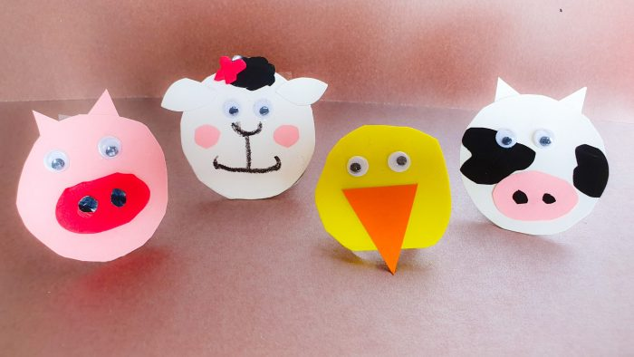 farm animal finger puppets placed on a surface