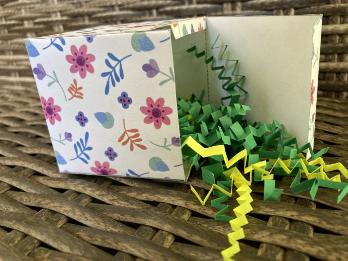 gift box filled with  colorful shredded paper