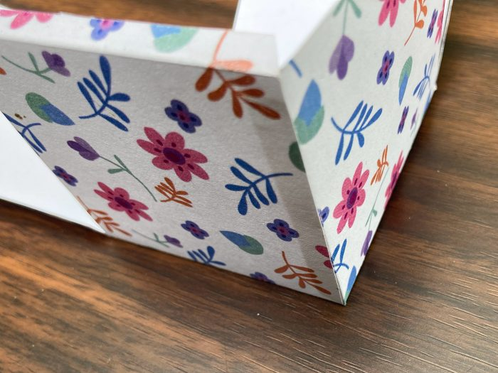sides of gift box template joined to form a box