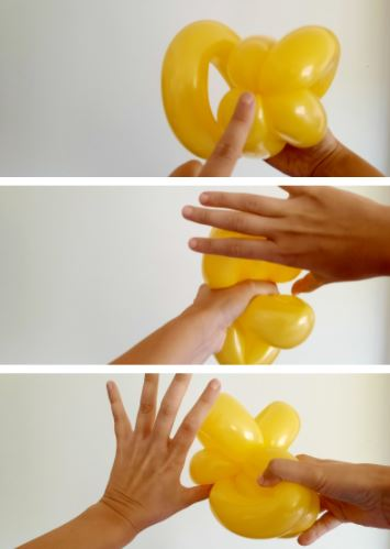 twisting of balloon ovals to form flower petals