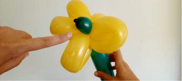 attaching balloon stem to the balloon flower