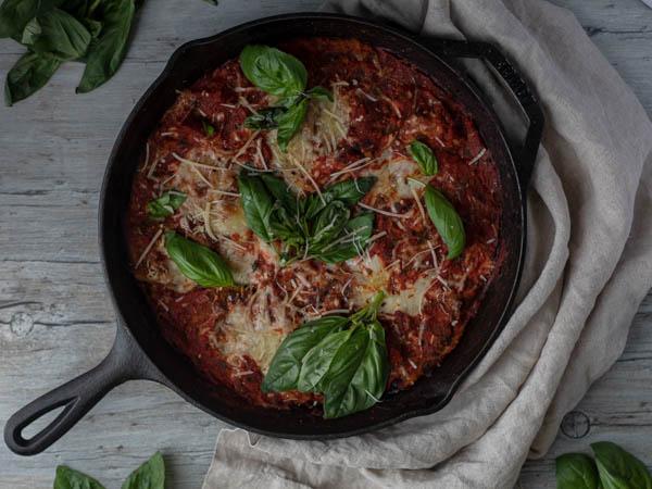 veal parmesan garnished with fresh basil