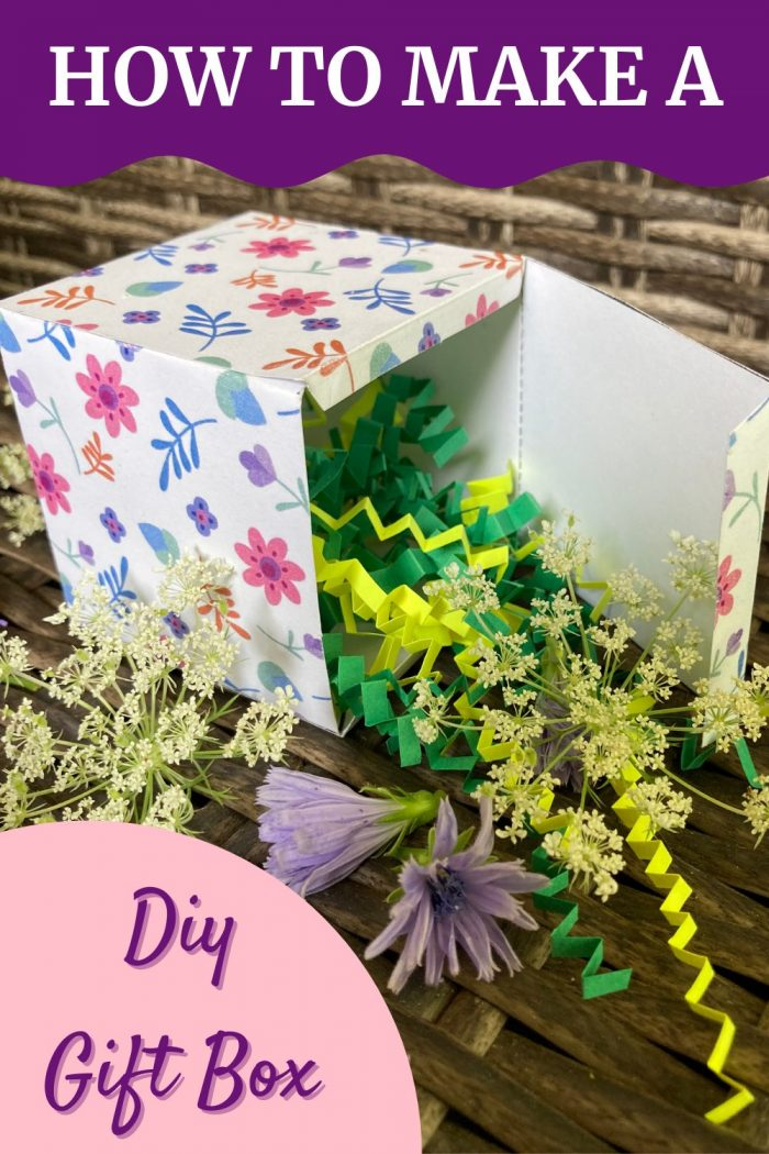 DIY gift box with shredded paper and flowers in it