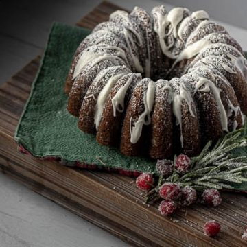 Gingerbread bundt cake with white icing glaze